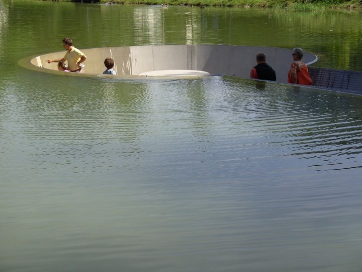 Westpol architects created this wonderfully picturesque spot in Vöcklabruck, Austria where visitors are able to sit in the middle of a pond without getting wet. The scenic landscape includes a path leading down to a hollowed out circular area where people can take a seat and relax amongst nature.