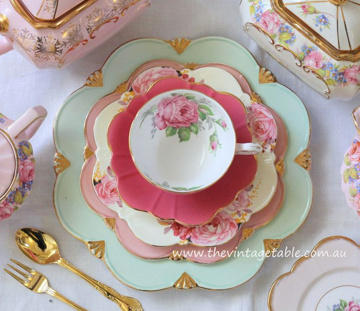 High tea party place setting from The Vintage Table, Perth.  Pretty pink roses teacups, teapots and vintage gold cutlery.