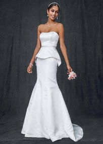 It's all in the details and this trumpet wedding gown doesn't miss a beat. Stylish and unique, this mermaid gown says chic sophistication all over. Satin strapless gown features a beaded waistband. Statement making peplum skirt detail adds that unique and memorable component every girl is looking for in her wedding dress! Chapel train. Size 0-14. Petite: 7T3518 $399 0P-14P (special order only). Woman: 9T3518 $449 16W-26W (special order only). Available in select stores and online in Ivory…
