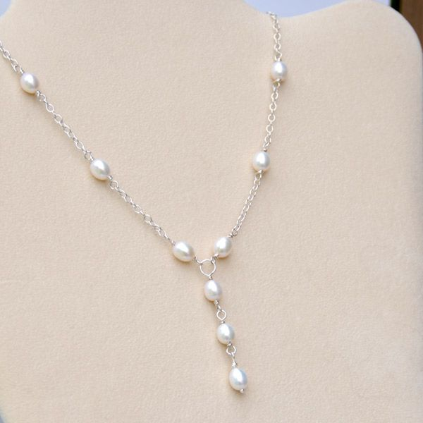This beautiful sterling silver handcrafted necklace is so elegant with a graceful pendant drop of 3 wire wrapped freshwater pearls set on a chain with 3 more wire wrapped pearls on either side.  Bethany is a very comfortable lightweight design to wear and drapes beautifully.   A wonderful design for smart casual wear or to show off your evening elegance. Looks fabulous with v-necks or low necklines.