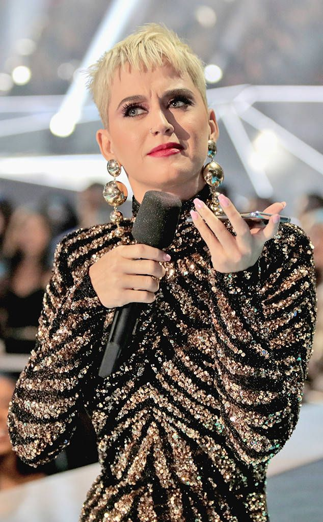 "Louder Than a Lion from Katy Perry's 10 Looks at the 2017 MTV VMAs Perry made the audience ""Roar"" with her sequined zebra-print Naeem Khan gown."
