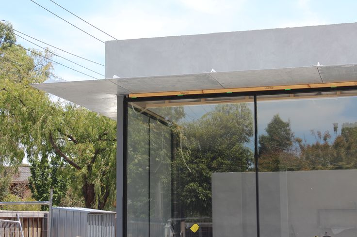 Hawthorn House by Jacobs Thomas & Associates. Scaled up linear planes and large glazed sections create a living/backyard space with resonance. Under construction.