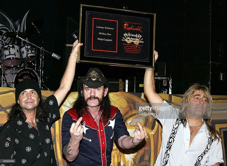 Motorhead gets inducted into Hollywood's RockWalk at the Whisky A Go-Go September 1, 2003 in Hollywood, California. They will be performing tonight at the legendary club and they are (l to r) Philip Campbell, Lemmy Kilmister and Mikkey Dee.    (Photo by Carlo Allegri/Getty Images)