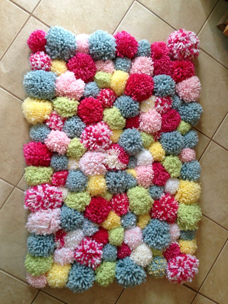 DIY POM POM rug...so easy even my husband helped!