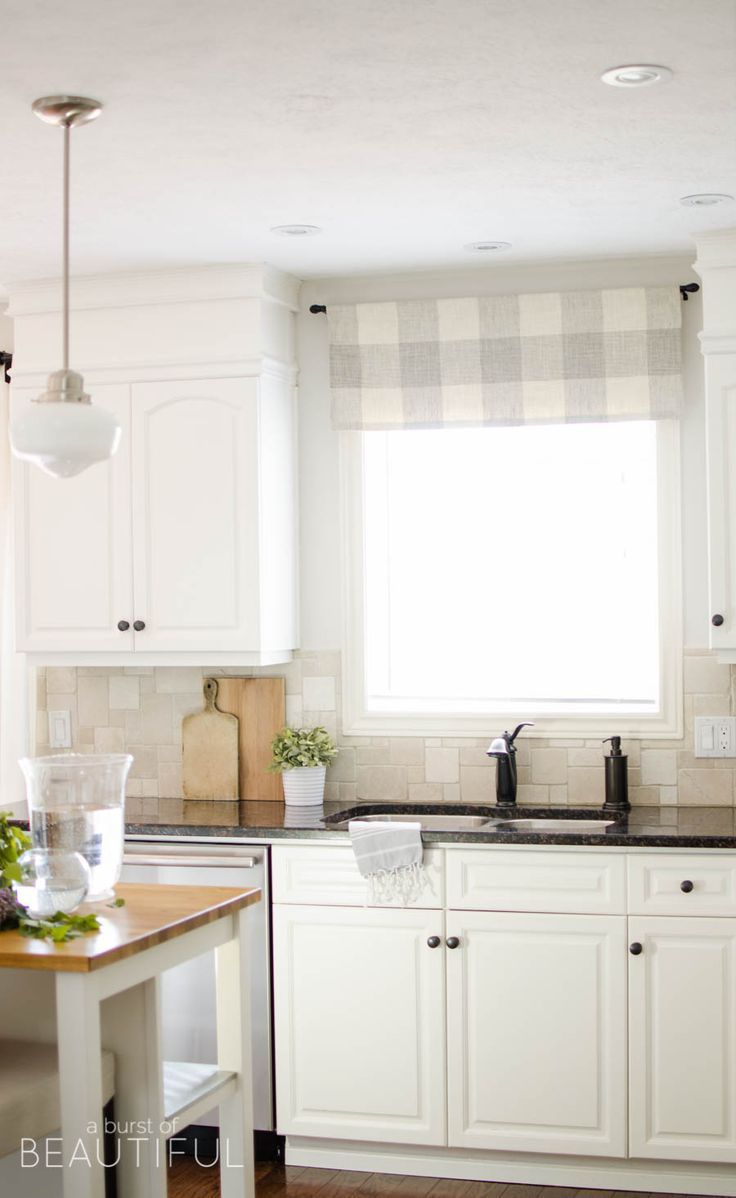 The kitchen has been completely renovated with fresh white cabinets - Summer Home Tour 2016 Classic White Kitchenwelcome