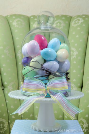 Display Easter eggs under a glass dome for a bright and cheery centerpiece!