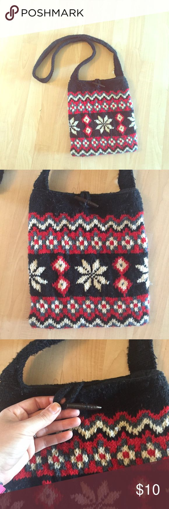 dELiA*s Fairisle Sweater Messenger Bag Navy, red , gray, and white knit sweater material Lined inside Velcro closure on inside with wooden toggle and loop closure on the outside Makes a great holiday gift! *I will gladly use my fabric shaver to remove all the pilling before shipping this.  #messengerbag #crossbody #fairisle #sweaterbag #holiday #gift Delia's Bags Crossbody Bags