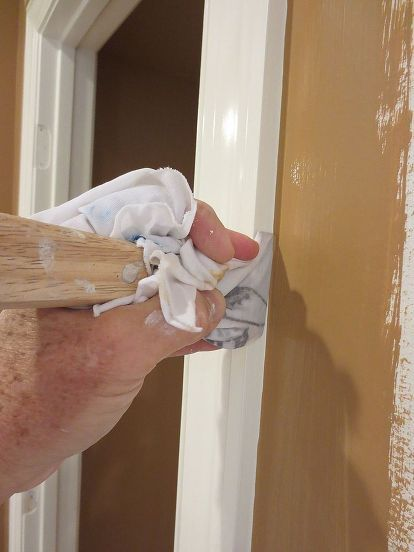 painting a straight line next to the trim trick, painting, To make the line even straighter take your 5 in 1 tool wrapped with a wet rag and drag it down the corner At just the right angle this will give you a crisp straight line
