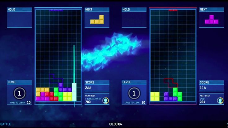 Two people face off against each other in a Tetris battle.