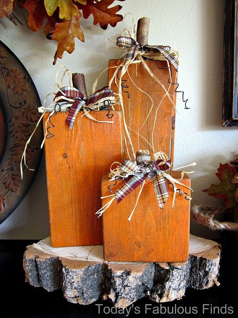 2x4 pumpkins..so simple! ~ I am going to make these this year, but will paint the other side with Christmas colors to look like gifts and change the bows to ribbon for continued use through out December!!!