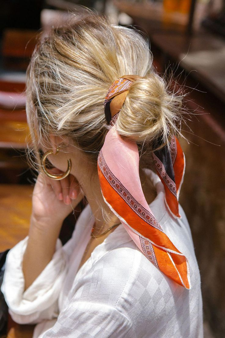 the trendiest way to wear your hair: tie it up in a printed scarf, hair bun tied…