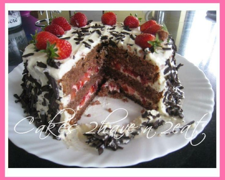 BLACK FOREST CAKE! YUMMY AND DELICIOUS! THREE LAYERS OF CAKE, TWO LAYERS OF FILLING AND SURROUNDED BY WHIPPED CREAM ALL FROM SCRATCH! (EXCEPT FOR THE STRAWBERRIES