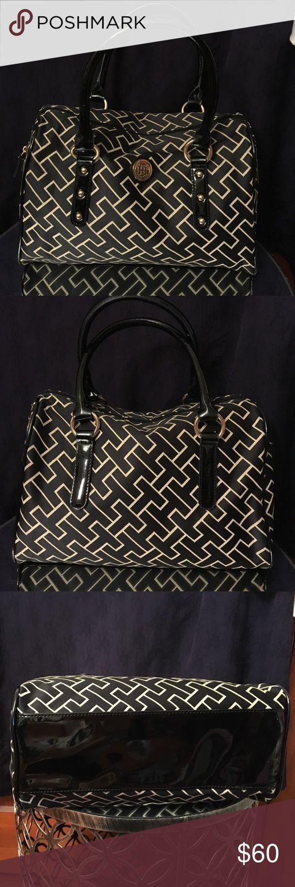 NWOT Tommy Hilfiger handbag NEW! TH purse. Black/Tan/gold. 1 zipper pocket inside/2 smaller pockets. Approx measurements: 16x4x8 Tommy Hilfiger Bags