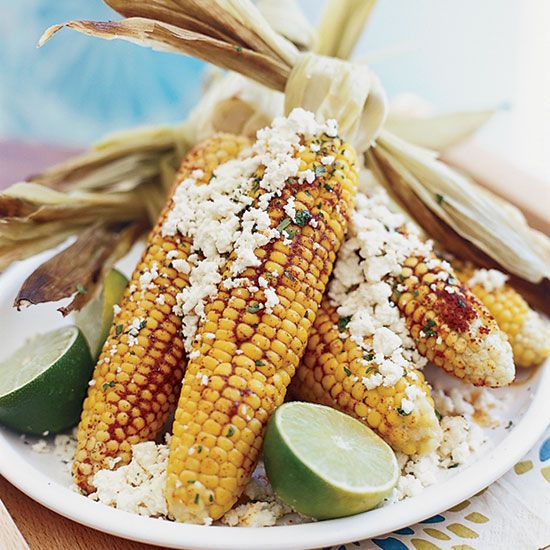 Grilled Corn with Queso Fresco and Lime-Tarragon Butter |This recipe is based on typical street food in Oaxaca, Mexico, where Michelle Bernstein once lived. The corn is typically smothered in mayonnaise, dipped in cheese and then covered with a spicy chile powder. #FOODWINEWOMEN