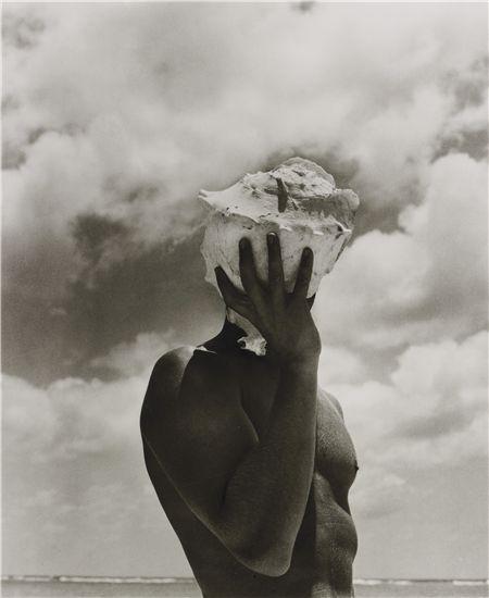 HERB RITTS, Man Holding Shell, Australia, 1986