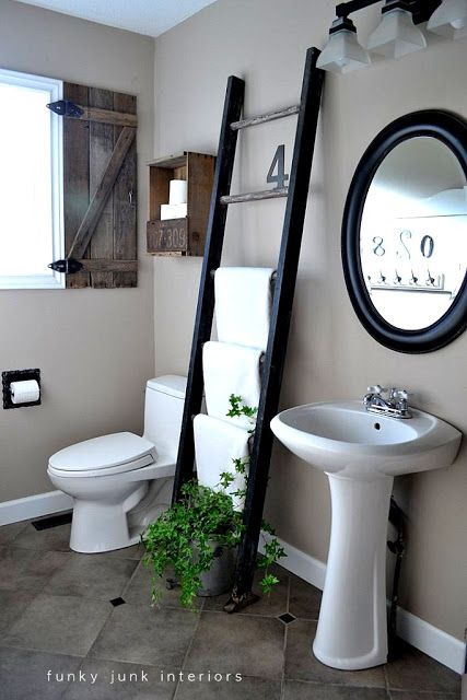 A bathroom with a ladder... and a toilet paper crate. A before and after via Funky Junk Interiors