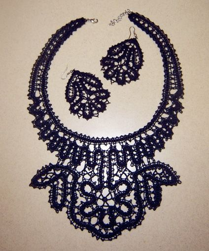 A necklace and a pair of earrings are made of Russian bobbin lace. #beauty #design #lace #Russian