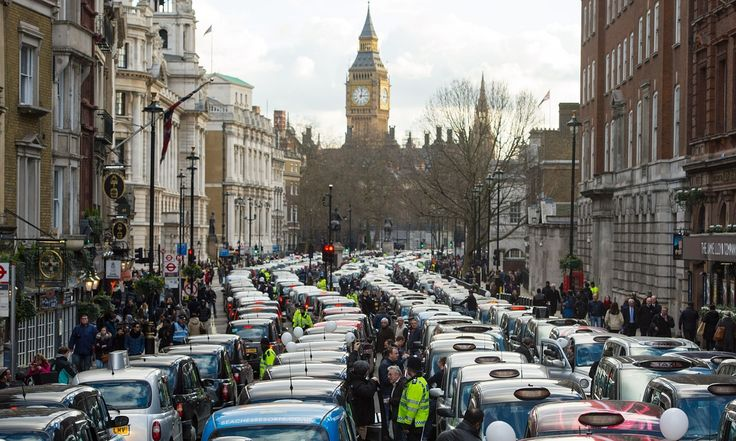 Black-cab drivers' Uber protest brings London traffic to a standstill. Organisers say about 8,000 drivers took part to highlight threat to their trade from TfL's licensing of taxi-hailing app