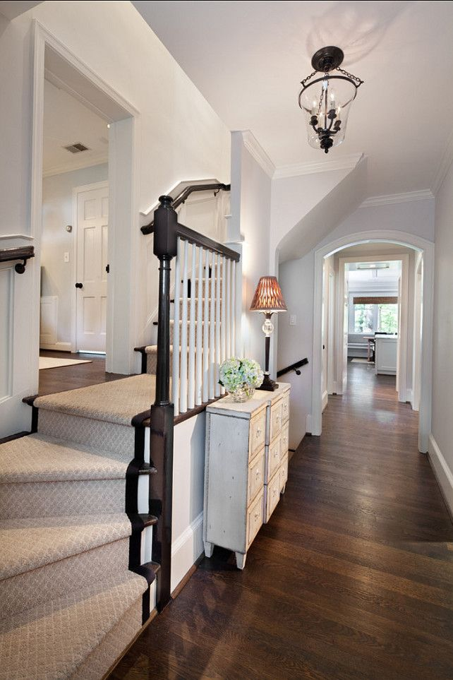 """A soothing color palette welcomes you as soon you open the door. Lighting is by """"Visual Comfort & Co."""" Cape Cod Renovation Ideas"""