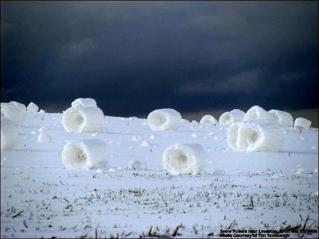 Top 10 Freaky Forces of Nature - snow rollers.  Snow rollers form when wet snow falls on ground that is icy, so snow won't stick to it. Pushed by strong winds, the snow rolls into logs.