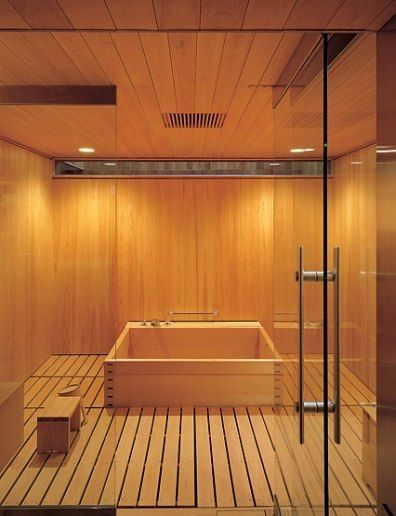 Bathroom with planked floor and ceiling.  The paneled walls and the tub are all made of cypress. (A Japanese Expression : Interiors + Inspiration : Architectural Digest)