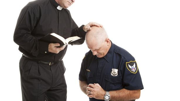 Atheist cop sues after being demoted to car washer for refusing to pray