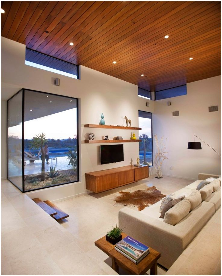 Minimalistic Sunken Living Room Design With Glass Box Windows