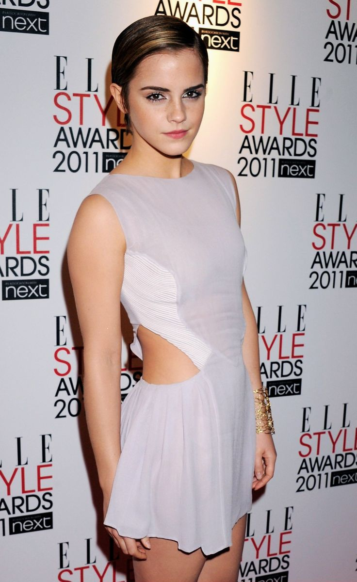 Emma Watson with a pixie cut. Too cute.