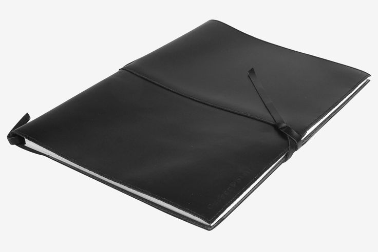 Handmade from genuine leather hide, the look, feel and smell of the Outback collection is reminiscent of our pioneering past, still alive in Outback Australia today. Stylish in design, the simple raw cut edges characteristic of the Outback collection make it a classic must have.The Outback compendia features a neat leather tie to keep your collection of notes, sketches and stories together securely. http://www.byariane.com.au/Corban&Blair-A4-Compendia-Outback-Black