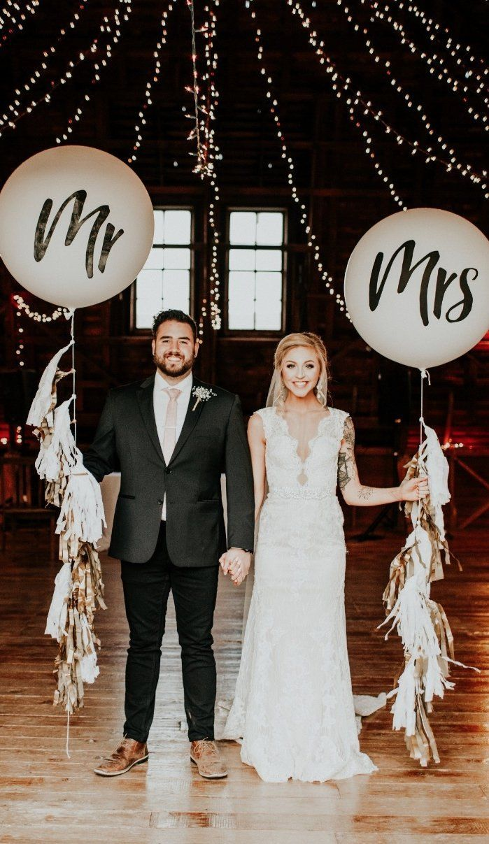 Giant balloons + twinkle lights + tassels because what's a wedding without whimsy?