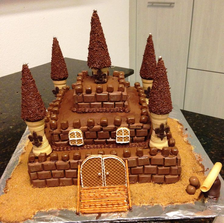 Castle Cake. I was trying to bake a cake for my 6 year old boy's birthday party, I always try to wow him and this time was not an exception...I loved my cake and my little boy and his friends too...Mission accomplished!!
