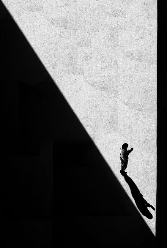 Shadow people by on fotoblur triangular shape open space diagonal lines high vantage point