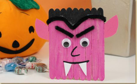 Handmade Dracula Halloween Craft. Use glow in the dark paint and wood craft sticks to create a Dracula designed Halloween craft to display at your party!
