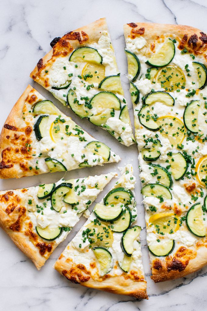 An easy summer pizza recipe made with fresh zucchini, garlic, lemon, goat cheese, mozzarella and chives.