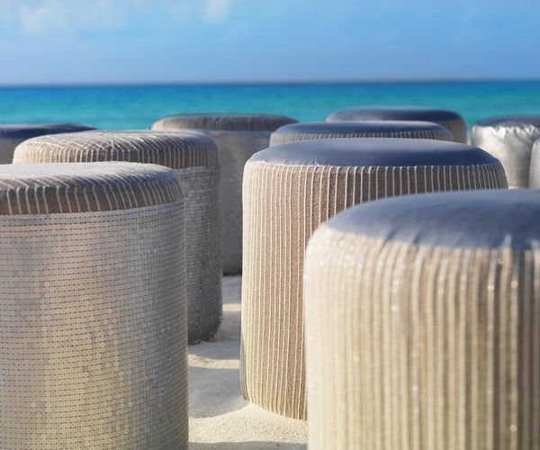 Beaded linen stools for wedding ceremony guests at beach wedding | Metallic Sands Collection at Palace Resorts #destinationwedding