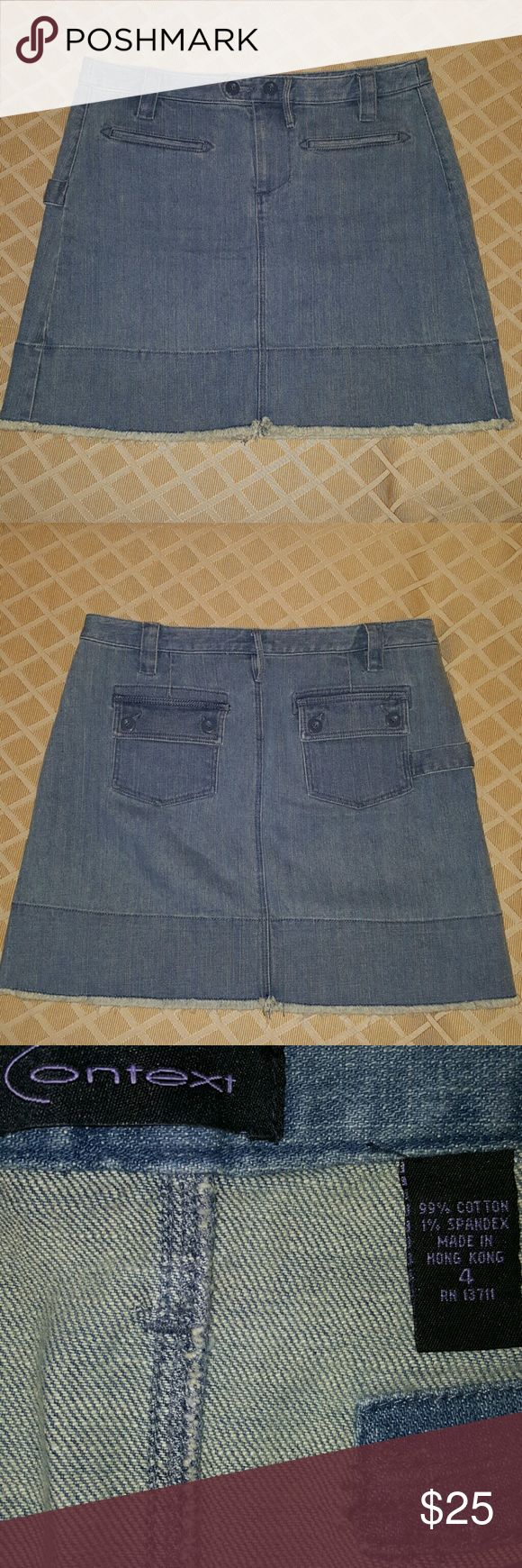 """Ladies Context Denim Skirt Size 4 Like new Context Denim Skirt, slight give to denim 1% spandex. Very chic and fashionable. Midi skirt approx 2"""" above knee. Stonewash blue, frayed trim, button and zip, pockets and belt loops. Context Skirts Midi"""