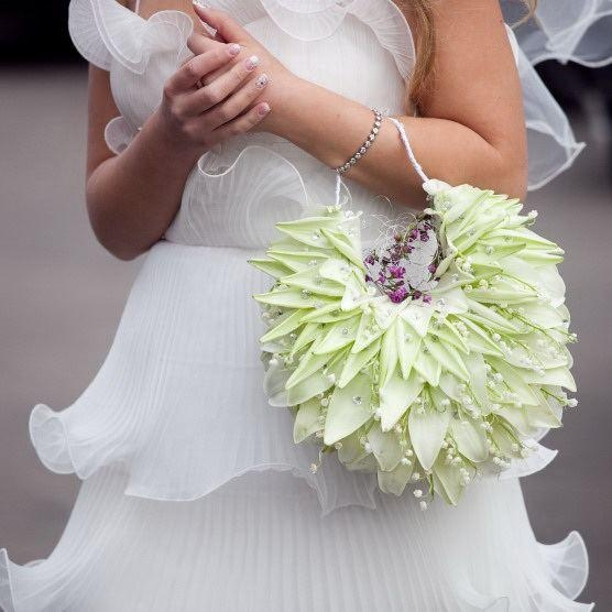 Gorgeous bridal purse made from composite lily petals, lily of the valley and floral materials. Designer unknown.