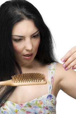 Postpartum Hair Loss: Don't panic, here's why and what to do about it.
