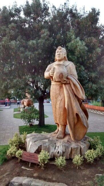 Plaza de armas Pucon.Escultura en madera.