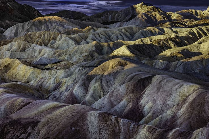 Zabriskie Point - Death Valley provides some of the most remarkable shapes, colors, and hues you can find in the American Southwest. Zabriskie Point is no exception. For this reason, sunrise at Zabriskie Point is the most popular photographic spot in Death Valley. Would you like to photograph this iconic place for yourself? Find out all the tools and information you will need at Photographers Trail Notes. All your research already done for you, all in one spot.