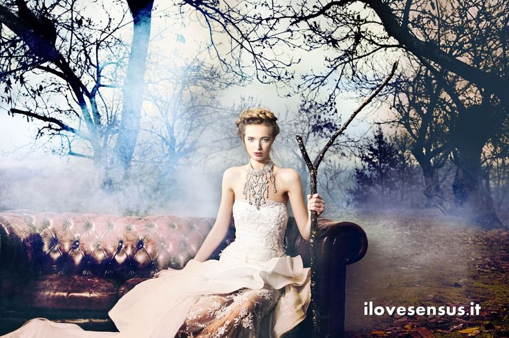 Woman on a couch in a woodland. Hairstyle blond updo