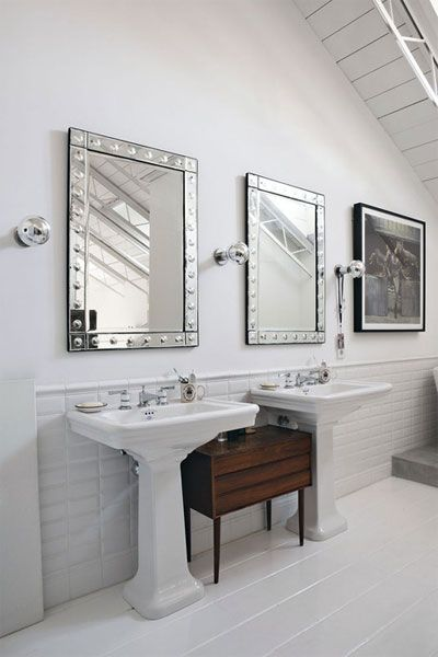 Suzie: Sleek bathroom with twin glossy white pedestal sinks, Williams-Sonoma Home Etched-Dot ...LOVE THE MIRRORS