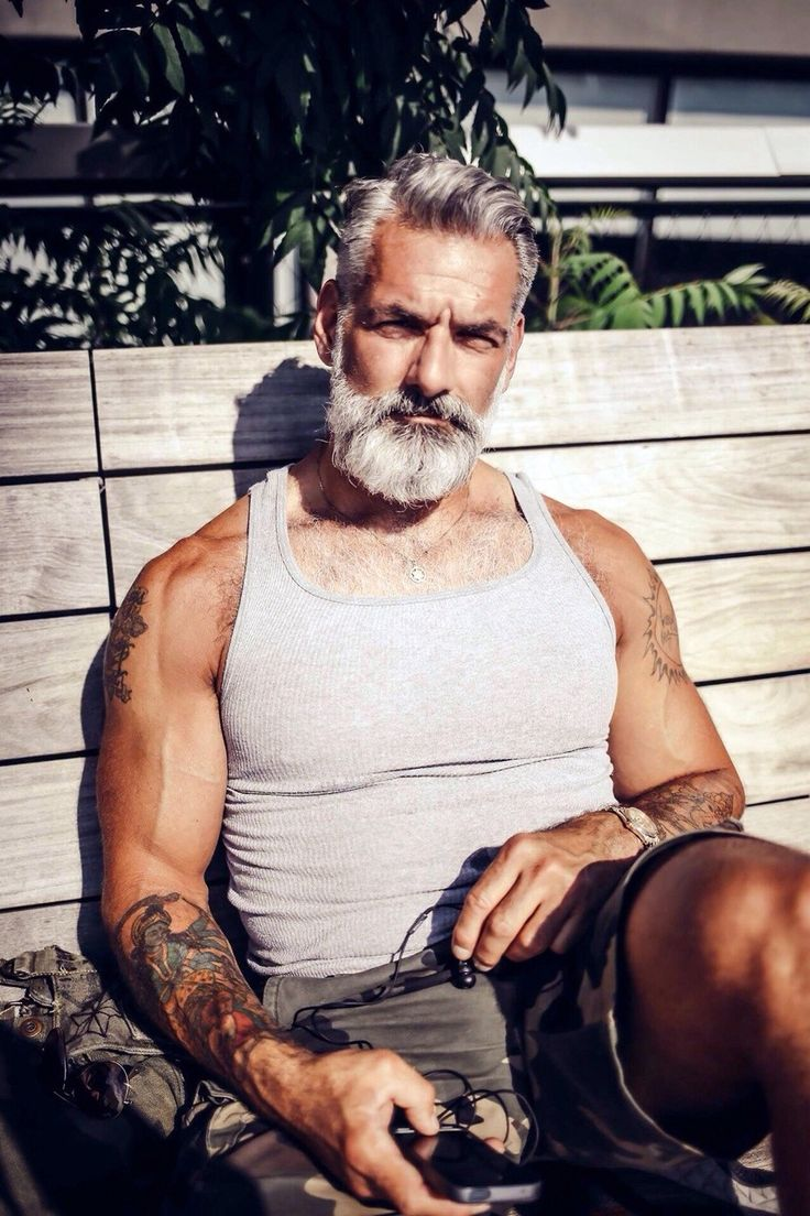 This dude makes me completely re-examine and re-think the prospect of aging!!  Talk about aging gracefully@ Silver Fox with beard, iPhone and tattoos…