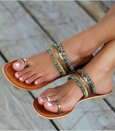 Embellished sandals.