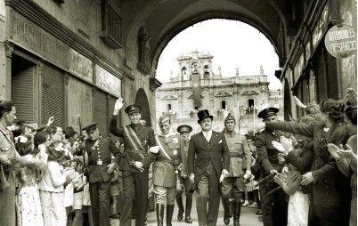 "Farewell to Portuguese ""Viriatos"" volunteers - 4th june 1939 - Plaza Mayor, Salamanca, Spain - Portuguese Ambassador Pedro Teotonio Pereira (left, dark uniform), Millan Astray (center, light grey uniform) and Ambassador of Spain in Portugal Nicolas Franco (right, civilian clothes)"