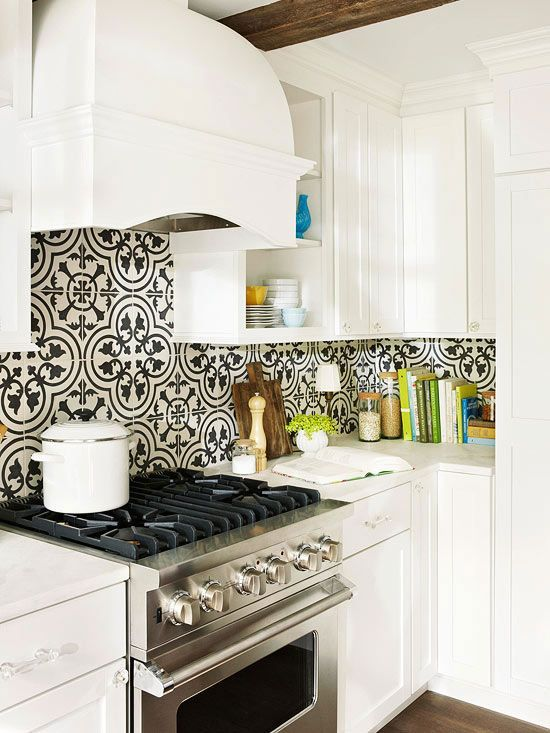 A black-and-white color combination is dramatic. When using the duo in a kitchen with white cabinets, keep the look from becoming theatrical by practicing restraint. Opt for black-and-white patterns with an organic or curvy aesthetic, rather than sharp and geometric, and use the black in small doses.