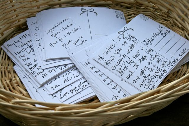 instead of a guest book, guests can write postcards that will be mailed periodically to the new couple in their first year of marriage. sweet!