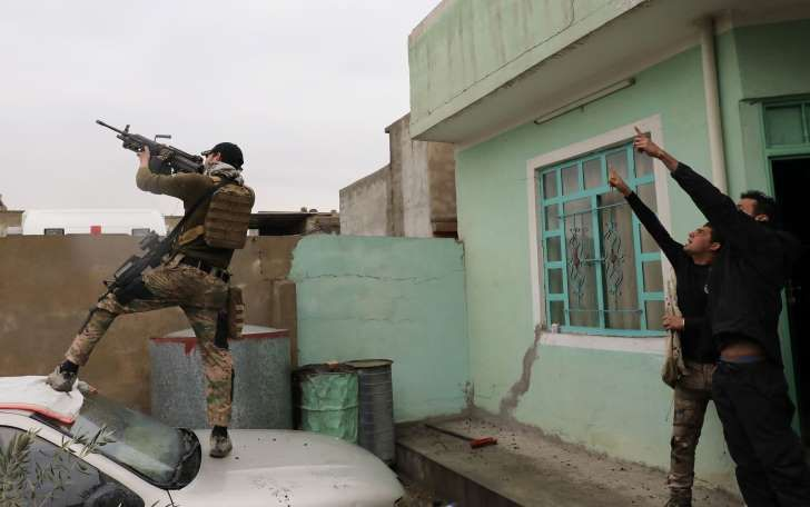 An Iraqi special forces soldier fires at a drone operated by Islamic State group (ISIS) militants in Mosul, Iraq, March 4, 2017. Such aircraft are relatively cheap, low-tech ways in which ISIS can target enemies.