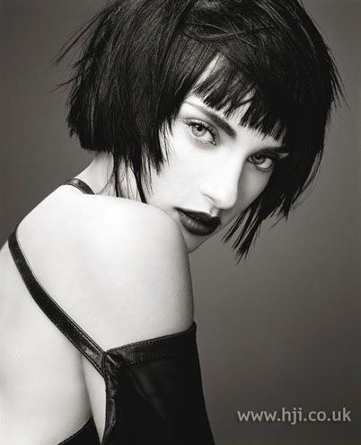 """Short black hair was cut into a blunt bob with overhanging sections through the sides and straightened     Hairstyle by: Robert Cromeans for Paul Mitchell  Location: America"""