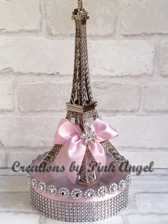 THIS LISTING IS FOR 1 (one) Large Silver Eiffel Tower Centerpiece. Centerpiece measures 12 tall when put together (tower on top of base). The clear acrylic round base is 2 tall with a 6 diameter, and it opens up for you to fill up with anything you desire: potpourri, sweets, led lights, etc. VERY IMPORTANT: For your convenience Eiffel Tower and base are not attached together. Please note that I am using a 10 tall METAL Eiffel Tower. This item ships out PRIORITY MAIL. If you would like to…